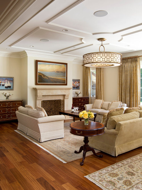Example Of A Mid Sized Classic Open Concept Medium Tone Wood Floor Living Room Design