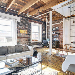 Large industrial mezzanine living room in New York with brown walls, light hardwood flooring, no fireplace, no tv and beige floors.