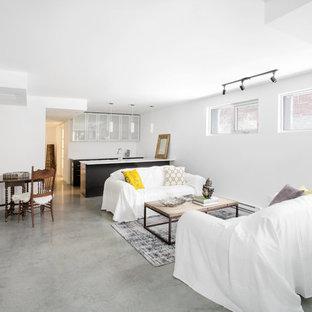 シアトルの中くらいのシャビーシック調のおしゃれな独立型リビング (フォーマル、白い壁、コンクリートの床、暖炉なし、テレビなし、グレーの床) の写真