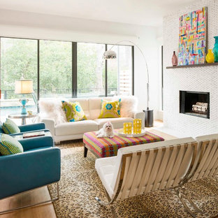Living room - mid-sized contemporary open concept light wood floor living room idea in Dallas with white walls, a standard fireplace and a tile fireplace