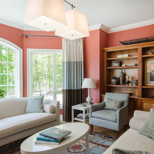 Inspiration for a transitional living room remodel in New York with orange walls