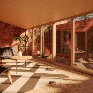 Inspiration pour un petit salon minimaliste ouvert avec un mur rouge, un sol en brique, un téléviseur fixé au mur et un sol beige.