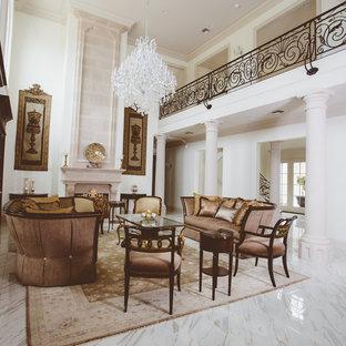 Ispirazione per un ampio soggiorno tradizionale aperto con sala formale, pareti bianche, pavimento in terracotta, camino classico, nessuna TV e pavimento bianco