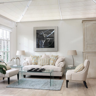 Design ideas for a classic living room in Sussex with white walls and beige floors.