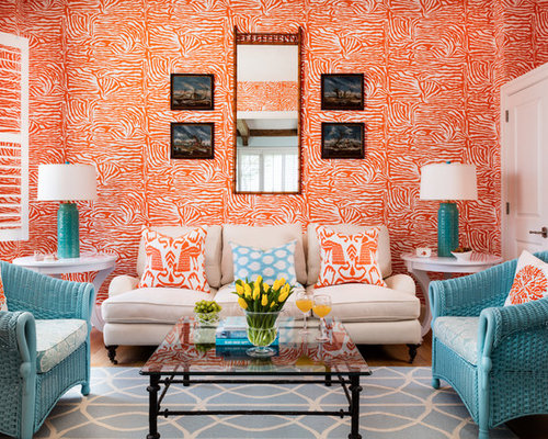 Large Island Style Formal Enclosed Living Room Photo In Miami With Orange Walls Light Wood