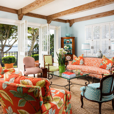Inspiration for a large tropical open concept and formal living room remodel in Miami with blue walls