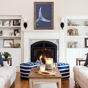 Large coastal formal and enclosed dark wood floor living room photo in Boston with a standard fireplace, a stone fireplace, white walls and no tv