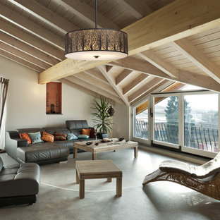 Example of a trendy formal concrete floor living room design in Salt Lake City with beige walls