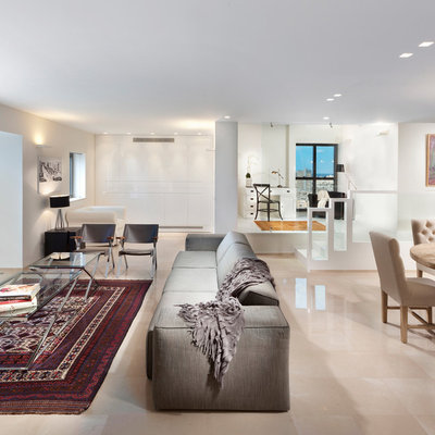 Living room - contemporary open concept living room idea in Other with white walls