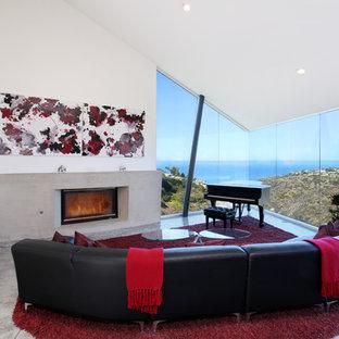 オレンジカウンティの大きいトロピカルスタイルのおしゃれなLDK (ミュージックルーム、コンクリートの床、横長型暖炉、テレビなし) の写真