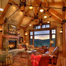 Rustic Living Room by Brooks Design / Build, Inc.