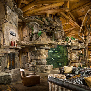 Mountain style open concept living room photo in Other with a corner fireplace and a stone fireplace