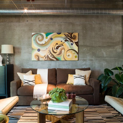 Living room - industrial open concept living room idea in Los Angeles with no tv