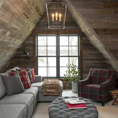 Living room - large rustic loft-style carpeted and beige floor living room idea in Minneapolis with brown walls, no fireplace and a tv stand