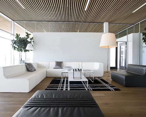 Inspiration For A Modern Medium Tone Wood Floor Living Room Remodel In  London With White Walls