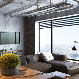Idee per un grande soggiorno industriale stile loft con angolo bar, pareti multicolore, pavimento in legno massello medio, camino bifacciale e TV a parete