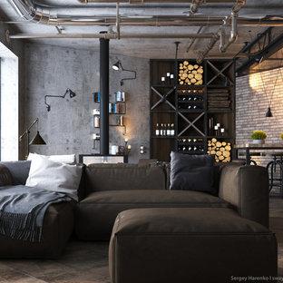 他の地域の広いインダストリアルスタイルのおしゃれなリビング (マルチカラーの壁、無垢フローリング、両方向型暖炉、壁掛け型テレビ) の写真