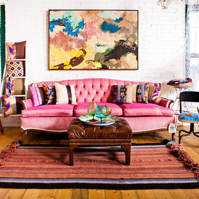 Inspiration for an eclectic medium tone wood floor living room remodel in Denver with white walls