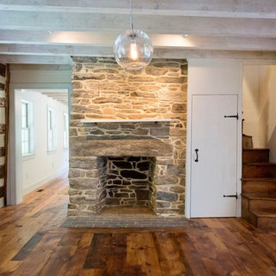Living room - mid-sized country formal and enclosed medium tone wood floor living room idea in Baltimore with white walls, a standard fireplace and a stone fireplace
