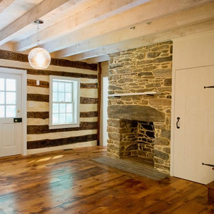 Example of a mid-sized cottage formal and enclosed medium tone wood floor living room design in Baltimore with white walls, a standard fireplace and a stone fireplace