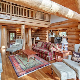 Example of a mountain style formal medium tone wood floor and brown floor living room design in Bridgeport with a standard fireplace, a stone fireplace and no tv