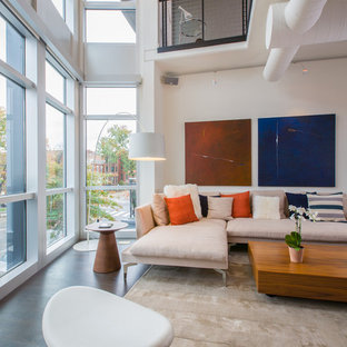 Living room - mid-sized modern loft-style dark wood floor living room idea in DC Metro with white walls