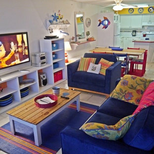 Example of a small coastal enclosed ceramic floor living room design in Austin with white walls, no fireplace and a tv stand