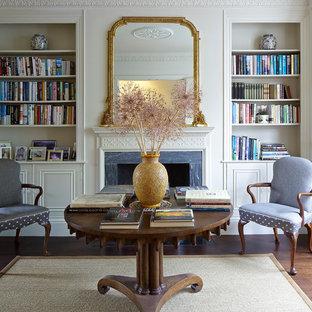 Idées déco pour un salon victorien avec un sol en bois foncé, une cheminée standard et un manteau de cheminée en pierre.