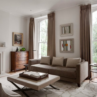 Traditional Formal Living Room In London With Grey Walls Light Hardwood Flooring A Standard