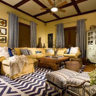 Example Of A Classic Medium Tone Wood Floor Living Room Design In New York  With Yellow