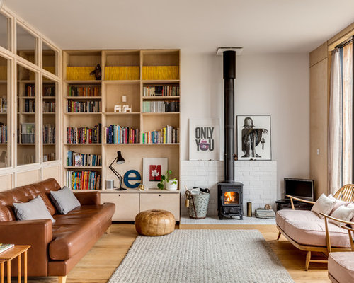 Scandinavian living room design ideas remodels photos - Wood stove ideas living rooms ...
