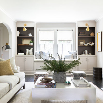 Inspiration for a transitional formal and open concept dark wood floor and brown floor living room remodel in New York with white walls, a standard fireplace, a tile fireplace and no tv