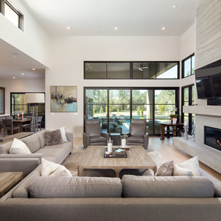 Mid-sized trendy formal and open concept light wood floor and beige floor living room photo in Sacramento with white walls, a wall-mounted tv, a ribbon fireplace and a concrete fireplace