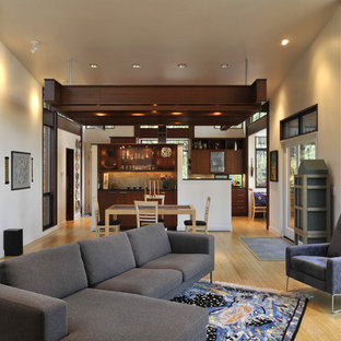 Living room - contemporary open concept living room idea in Seattle with beige walls