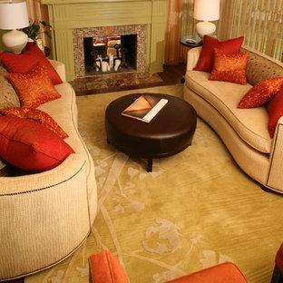 ポートランドの大きいトランジショナルスタイルのおしゃれな独立型リビング (フォーマル、黄色い壁、濃色無垢フローリング、標準型暖炉、石材の暖炉まわり、テレビなし) の写真