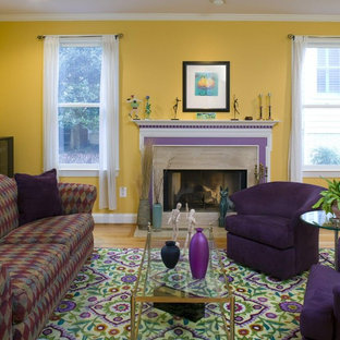 Photo of an eclectic living room in DC Metro with yellow walls.