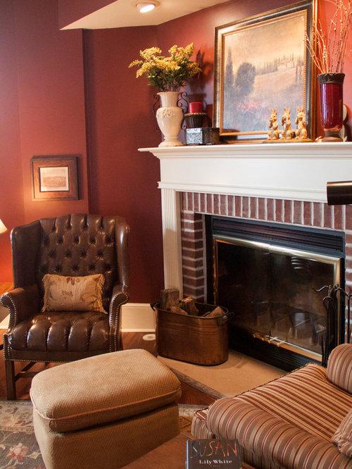 Wohnzimmer mit eckkamin und roter wandfarbe ideen design bilder houzz for Wohnzimmer design wandfarbe