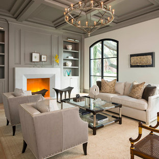 Mid-sized tuscan light wood floor and beige floor living room photo in Dallas with gray walls, a standard fireplace, a stone fireplace and no tv