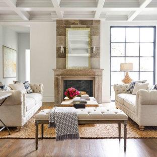 Ejemplo de salón para visitas abierto, tradicional renovado, sin televisor, con paredes blancas, suelo de madera oscura, chimenea tradicional y marco de chimenea de piedra
