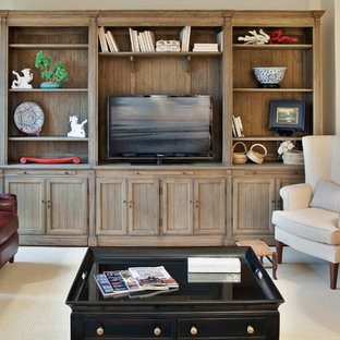 Design ideas for a traditional living room in Charleston with a freestanding tv.