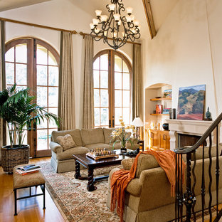 Design ideas for a medium sized traditional enclosed living room in San Francisco with beige walls, light hardwood flooring, a two-sided fireplace, a stone fireplace surround and no tv.