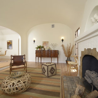 Mid-sized tuscan open concept and formal light wood floor living room photo in Los Angeles with white walls, a standard fireplace and a tile fireplace