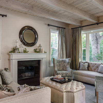Living room - traditional formal living room idea in San Francisco with beige walls and a standard fireplace