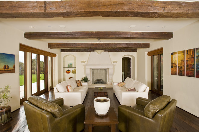 Rustic Living Room by Conrado - Home Builders