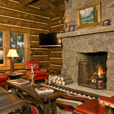 rustic living room by Teton Heritage Builders