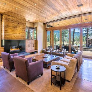 サクラメントの中サイズのコンテンポラリースタイルのおしゃれなLDK (ベージュの壁、セラミックタイルの床、横長型暖炉、金属の暖炉まわり) の写真