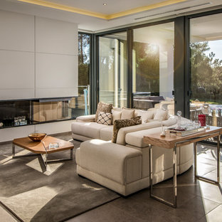 Contemporary living room in Geelong with white walls and grey floor.