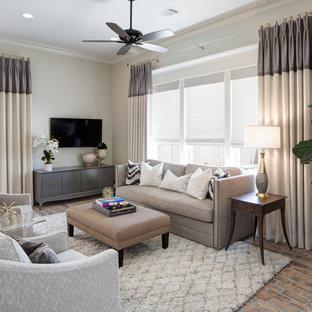 Foto di un soggiorno chic con pareti bianche, pavimento in mattoni, nessun camino, TV a parete e pavimento rosso