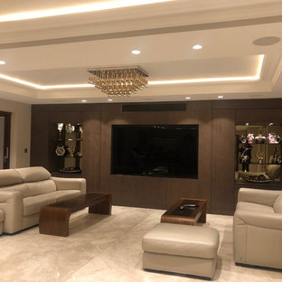 Large contemporary formal enclosed living room in London with brown walls, marble flooring, a built-in media unit and beige floors.