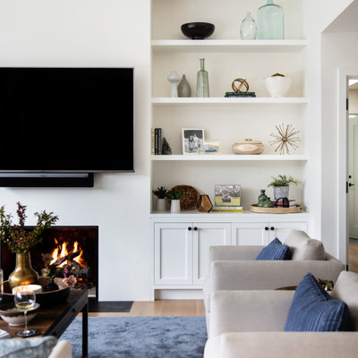 Living room - large transitional open concept beige floor living room idea in San Francisco with white walls, a standard fireplace and a wall-mounted tv
